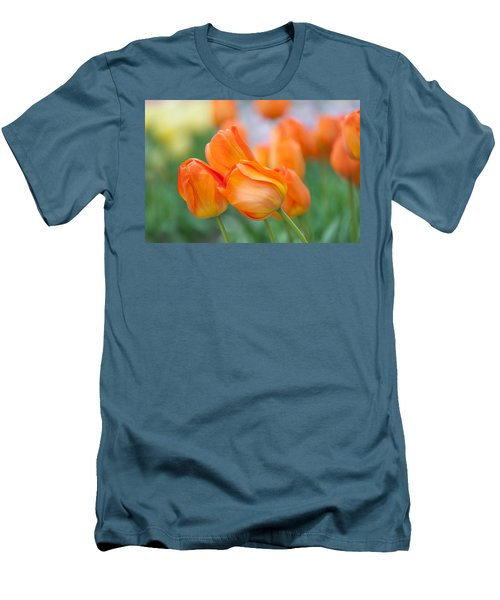 Men's T-Shirt (Athletic Fit) featuring the photograph Dutch Orange Tulips  by Jenny Rainbow