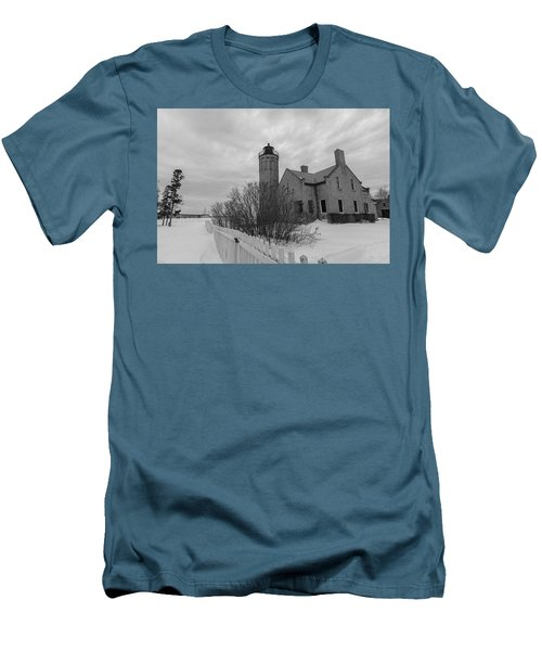 Men's T-Shirt (Slim Fit) featuring the photograph Lighthouse And Mackinac Bridge Winter Black And White  by John McGraw