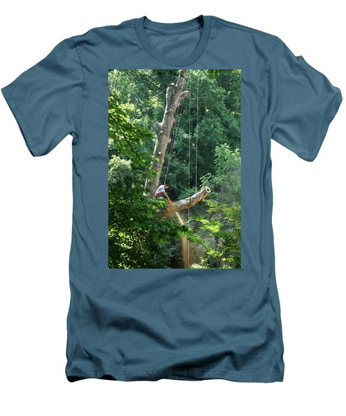 Men's T-Shirt (Slim Fit) featuring the photograph Logger Cutting Down Large, Tall Tree by Emanuel Tanjala