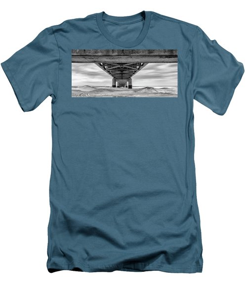 Men's T-Shirt (Slim Fit) featuring the photograph Mackinac Bridge In Winter Underneath  by John McGraw