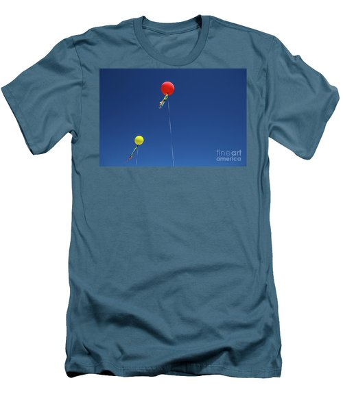 Men's T-Shirt (Athletic Fit) featuring the photograph Red,yellow Balloon Blowing By The Wind In The Air With The Blue  by Jingjits Photography
