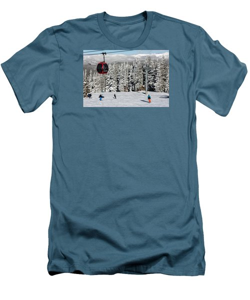 Skiers Limber Up Under A Gondola Near The Summit Of Aspen Mountain Men's T-Shirt (Athletic Fit)