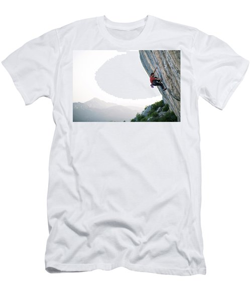A Climber On A Cliff In A Hilly Valley Men's T-Shirt (Athletic Fit)