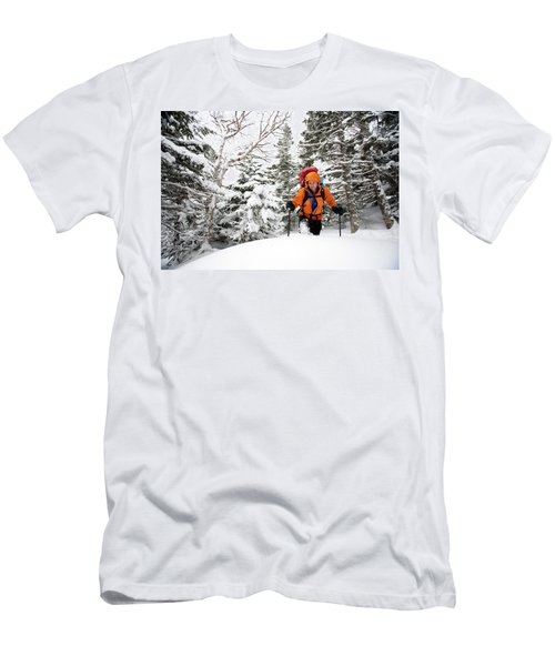 A Man Hiking Through The Snow On Mt Men's T-Shirt (Athletic Fit)