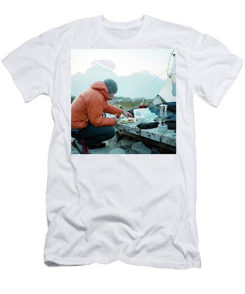 A Man Makes A Sandwich Next To His Tent Men's T-Shirt (Athletic Fit)