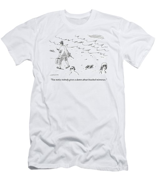 Two Minnows Lay On The Beach As Beach Goers Walk Men's T-Shirt (Athletic Fit)