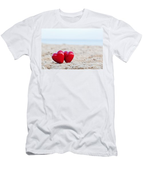 Two Red Hearts On The Beach Symbolizing Love Men's T-Shirt (Slim Fit) by Michal Bednarek