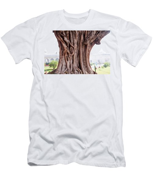The Twisted And Gnarled Stump And Stem Of A Large Tree Inside The Qutub Minar Compound Men's T-Shirt (Slim Fit) by Ashish Agarwal