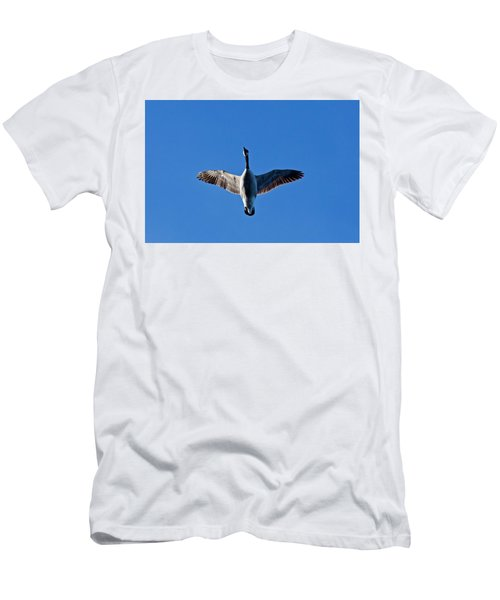 Men's T-Shirt (Slim Fit) featuring the photograph Candian Goose In Flight 1648 by Michael Peychich