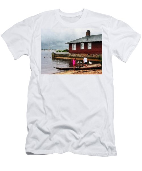 Children Playing At Harbor Essex Ct Men's T-Shirt (Slim Fit) by Susan Savad
