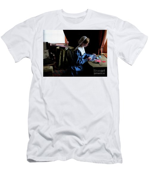 Men's T-Shirt (Athletic Fit) featuring the photograph Girl Sewing by Miles Whittingham