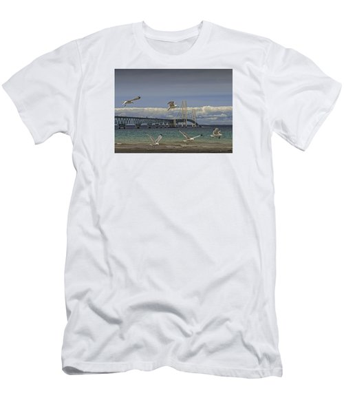 Gulls Flying By The Bridge At The Straits Of Mackinac Men's T-Shirt (Slim Fit) by Randall Nyhof