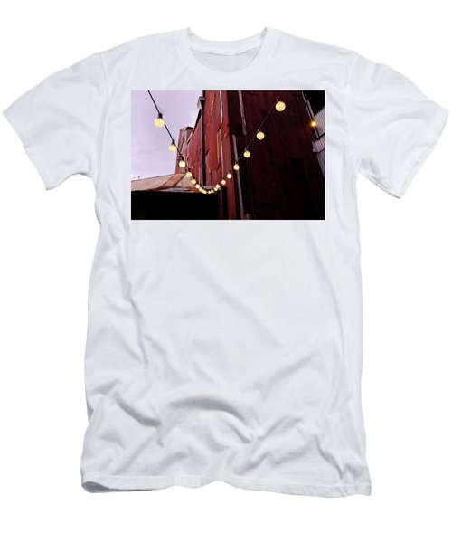 String Of Lights Near An Old Brown Building In Saint Augustine F Men's T-Shirt (Athletic Fit)