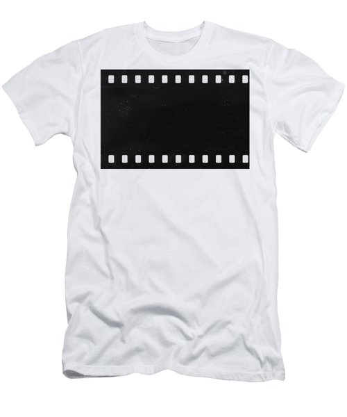 Men's T-Shirt (Slim Fit) featuring the photograph Strip Of Old Celluloid Film With Dust And Scratches by Michal Boubin