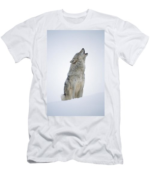 Men's T-Shirt (Athletic Fit) featuring the photograph Timber Wolf Portrait Howling In Snow by Tim Fitzharris