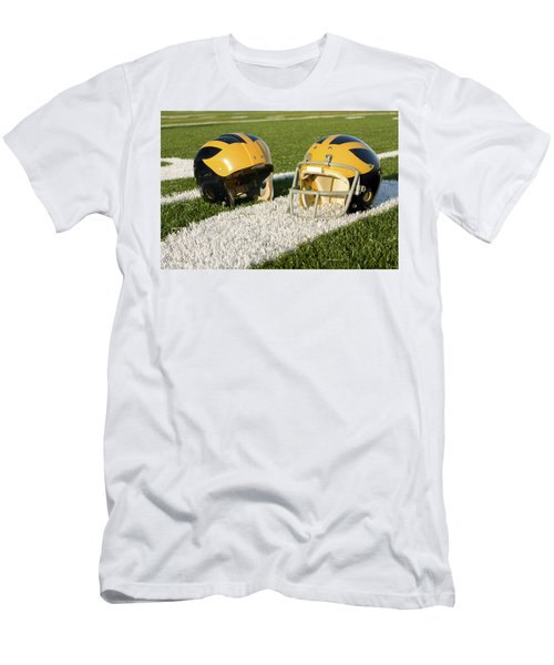 Wolverine Helmets From Different Eras On The Field Men's T-Shirt (Athletic Fit)