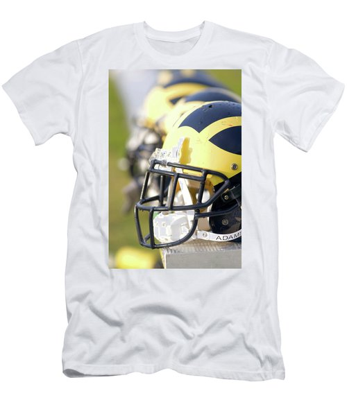 Wolverine Helmets On A Bench In The Morning Men's T-Shirt (Athletic Fit)