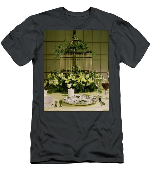 A Birdcage In The Middle Of A Table Men's T-Shirt (Athletic Fit)