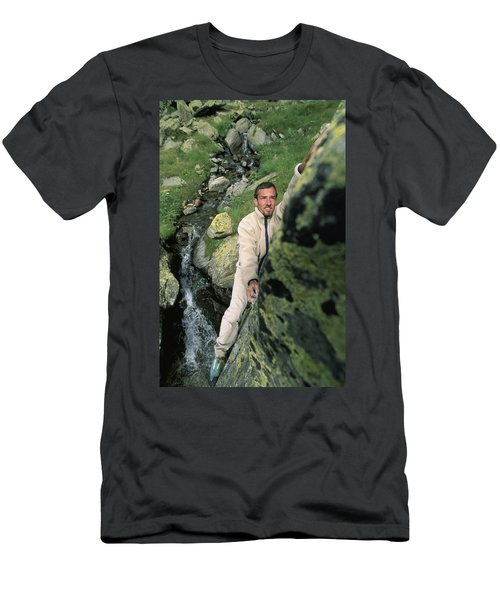 A Man Bouldering In Switzerland Men's T-Shirt (Athletic Fit)