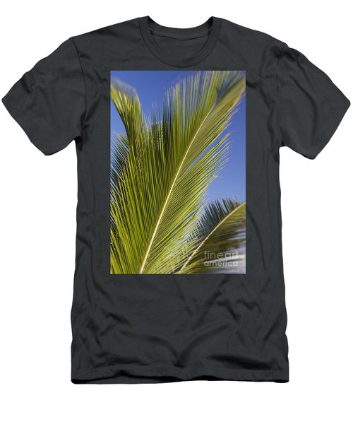 Men's T-Shirt (Athletic Fit) featuring the photograph Isabel Beach In Puerto Rico Palm Trees Against Blue Sky by Bryan Mullennix