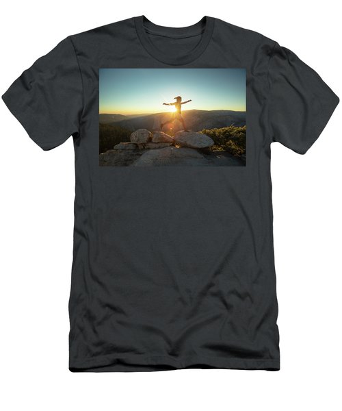 Person Leaping Along Rocks At Sunset Men's T-Shirt (Athletic Fit)
