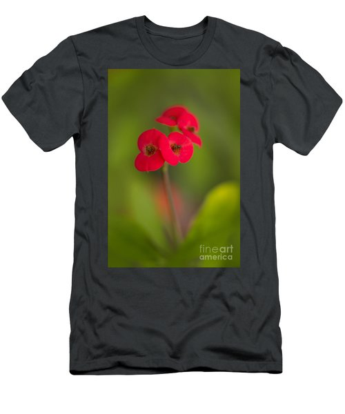 Men's T-Shirt (Athletic Fit) featuring the photograph Small Red Flowers With Blurry Background by Jaroslaw Blaminsky