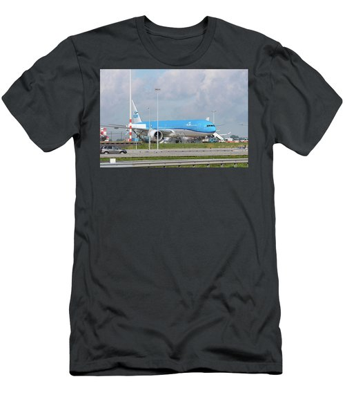 Men's T-Shirt (Slim Fit) featuring the photograph Klm Airplane At Amsterdam Schiphol Airport by Hans Engbers