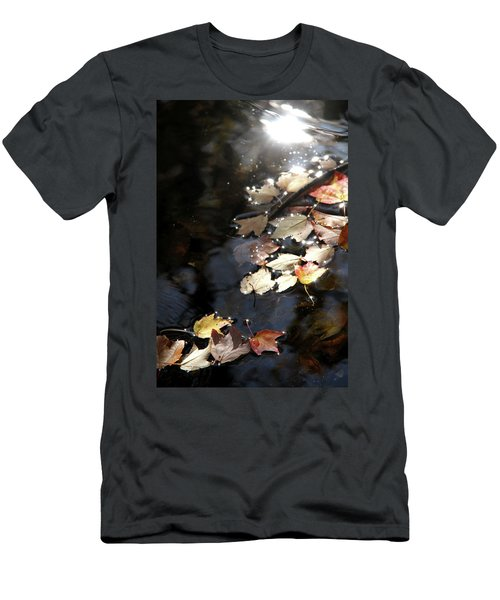 Men's T-Shirt (Slim Fit) featuring the photograph Dry Leaves Floating On The Surface Of A Stream by Emanuel Tanjala
