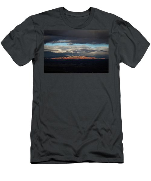 Men's T-Shirt (Slim Fit) featuring the photograph Late Light On Red Rocks With Storm Clouds by Ron Chilston