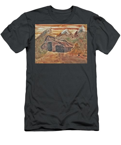 Old Farmhouse With Hay Stack In A Snow Capped Mountain Range With Tractor Tracks Gouged In The Soft  Men's T-Shirt (Athletic Fit)