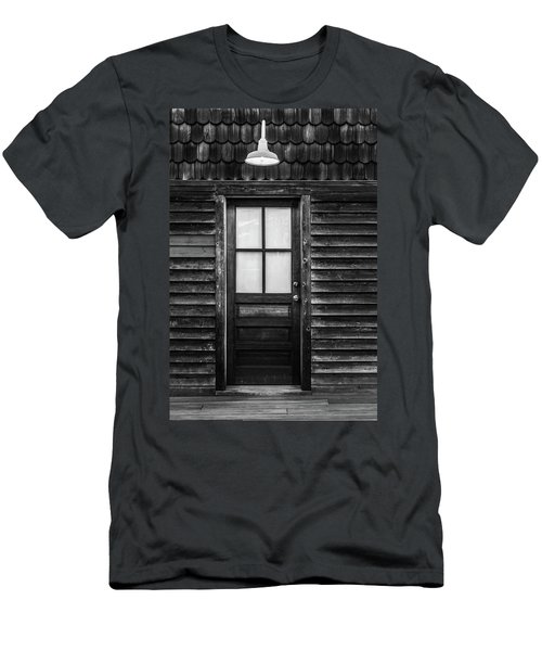 Men's T-Shirt (Slim Fit) featuring the photograph Old Wood Door And Light Black And White by Terry DeLuco