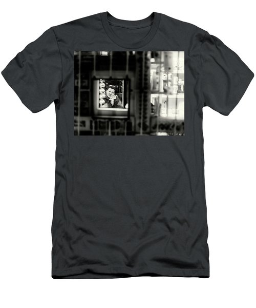 Men's T-Shirt (Athletic Fit) featuring the photograph Shopkeeper At Night by John Williams