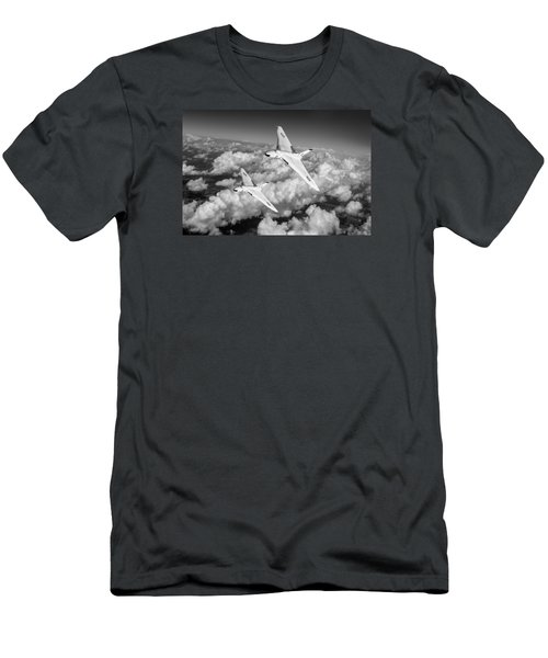 Men's T-Shirt (Slim Fit) featuring the photograph Two Avro Vulcan B1 Nuclear Bombers Bw Version by Gary Eason