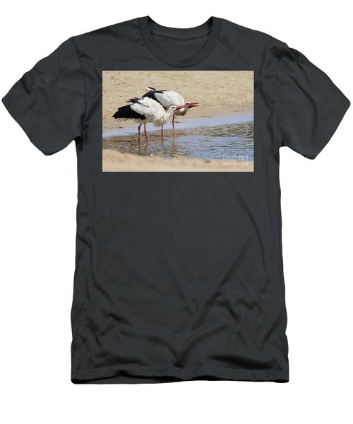 Men's T-Shirt (Athletic Fit) featuring the photograph Two Drinking White Storks by Nick Biemans