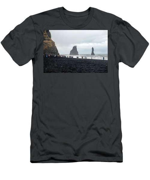Men's T-Shirt (Athletic Fit) featuring the photograph Visitors In Reynisfjara Black Sand Beach, Iceland by Dubi Roman