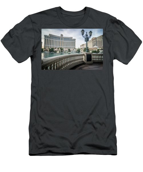 Men's T-Shirt (Athletic Fit) featuring the photograph Bellagio Hotel And Other Architecture In Las Vegas Nevada by Alex Grichenko