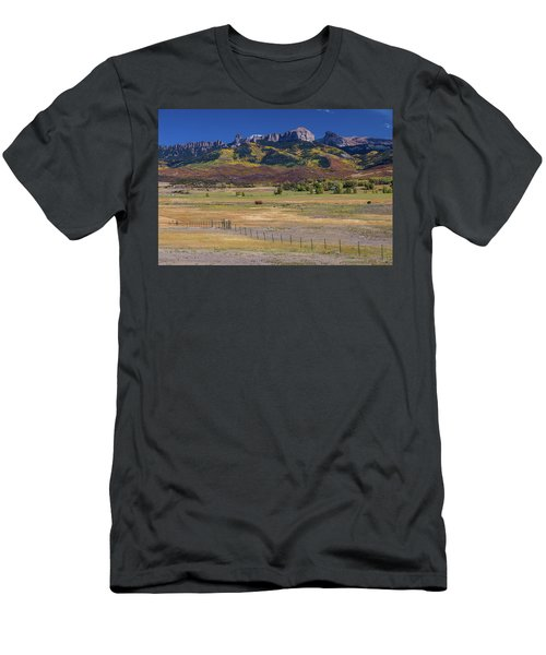 Men's T-Shirt (Athletic Fit) featuring the photograph Courthouse Mountains And Chimney Rock Peak by James BO Insogna