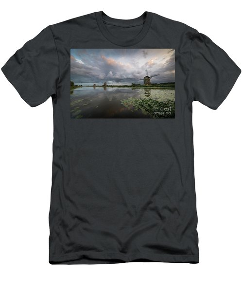 Men's T-Shirt (Athletic Fit) featuring the photograph Dramatic Sky Over Three Windmills In Holland by IPics Photography