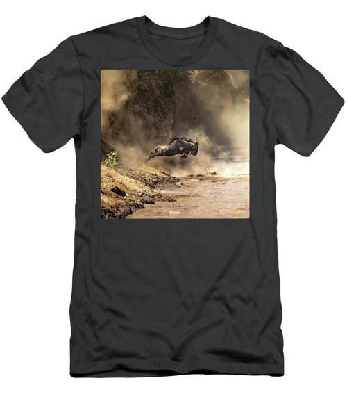 Wildebeest Leaps From The Bank Of The Mara River Men's T-Shirt (Athletic Fit)