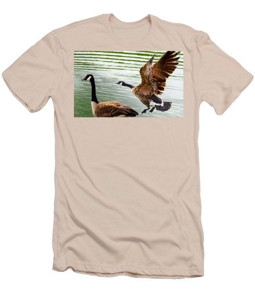 Men's T-Shirt (Slim Fit) featuring the photograph A Pair Of Canada Geese Landing On Rockland Lake by Jerry Cowart