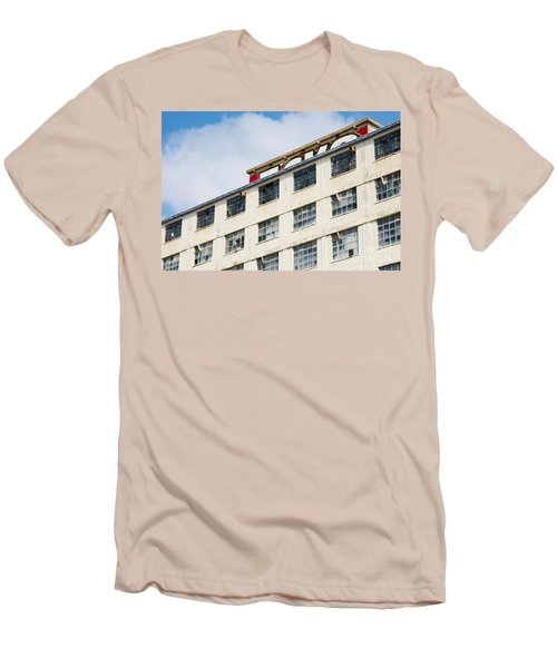 Men's T-Shirt (Slim Fit) featuring the photograph Old Factory Under A Clear Blue Sky by Nick  Biemans