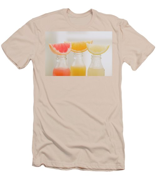 Three Fruit Juices In Bottles With Wedges Of Fresh Fruit Men's T-Shirt (Athletic Fit)