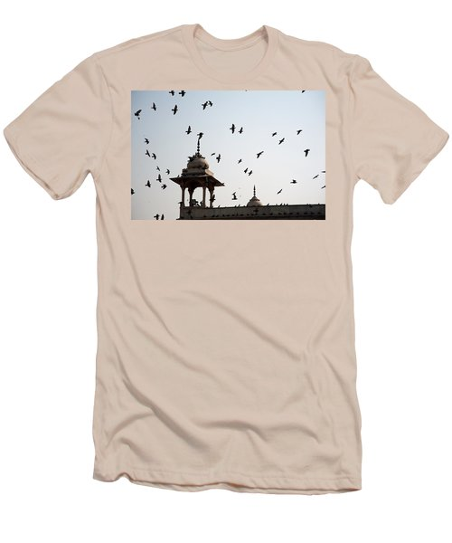 A Whole Flock Of Pigeons On The Top Of The Ramparts Of The Red Fort In New Delhi Men's T-Shirt (Slim Fit) by Ashish Agarwal