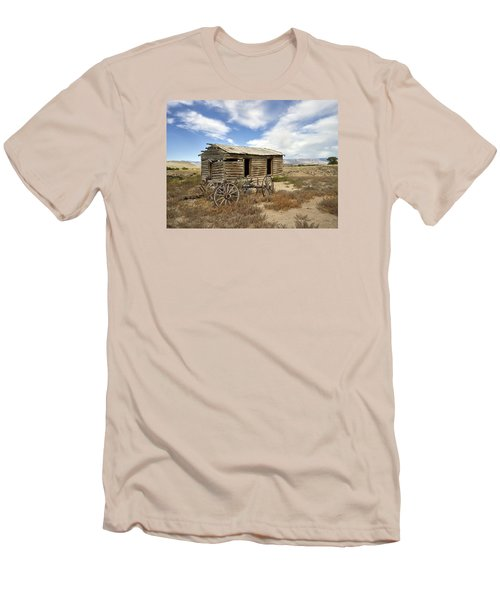 Historic Cabin And Buckboard Wheels In Big Horn County In Wyoming Men's T-Shirt (Athletic Fit)