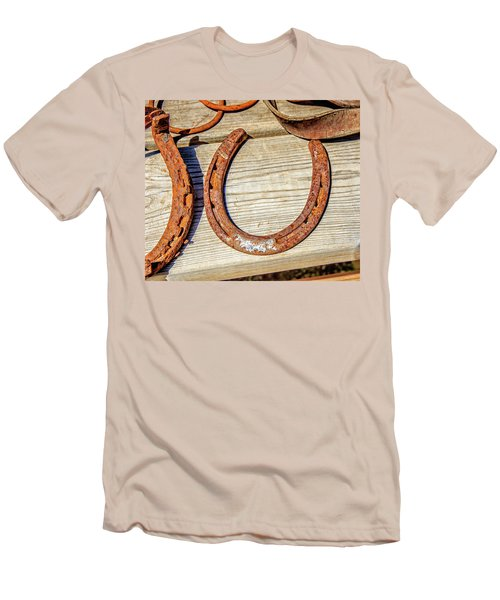 Men's T-Shirt (Slim Fit) featuring the photograph Rusty Horseshoes Found By Curators Of The Ghost Town Of St. Elmo by Peter Ciro