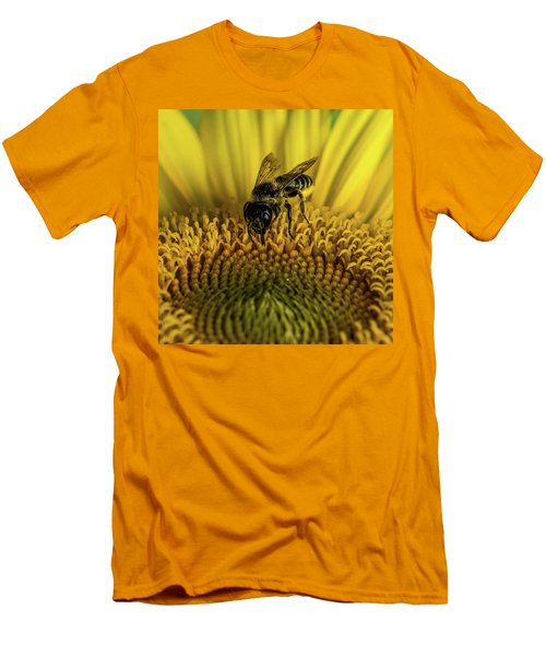 Men's T-Shirt (Slim Fit) featuring the photograph Bee In A Sunflower by Paul Freidlund