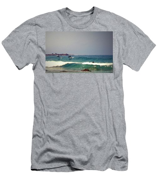 Dolphins Swimming With The Surfers At Asilomar State Beach  Men's T-Shirt (Slim Fit) by Joyce Dickens