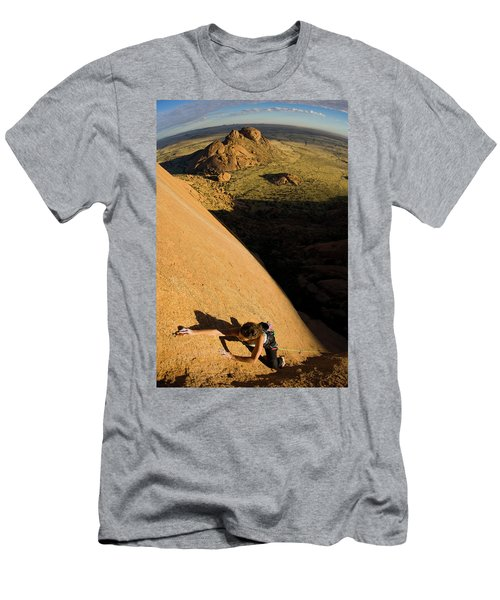 Female Athlete Climbing A 5.12b Route Men's T-Shirt (Athletic Fit)