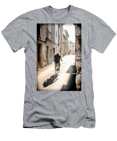 Man Riding Bicycle In Street In Puerto Pollenca Men's T-Shirt (Athletic Fit)