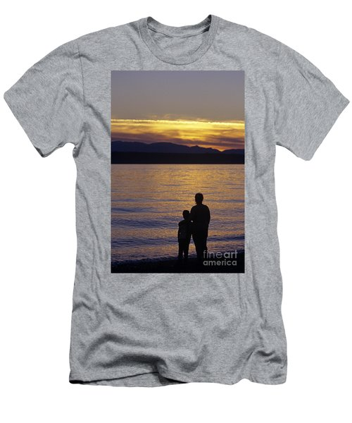 Mother And Daughter Holding Each Other Along Edmonds Beach At Su Men's T-Shirt (Athletic Fit)